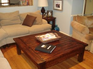 Make This DIY Coffee Table for $100 - Check out the story of how my first DIY peice of furniture turned into this amazing Farmhouse style coffee table for a fraction of what I would have spent at the furniture store!   https://heartenedhome.com