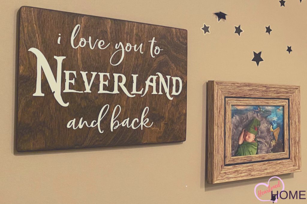 Neverland sign and framed print of baby as Peter Pan