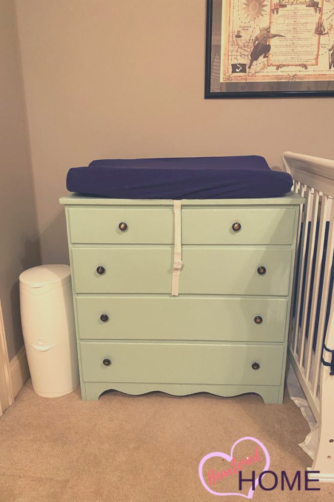 Changing station dresser with navy changing pad cover