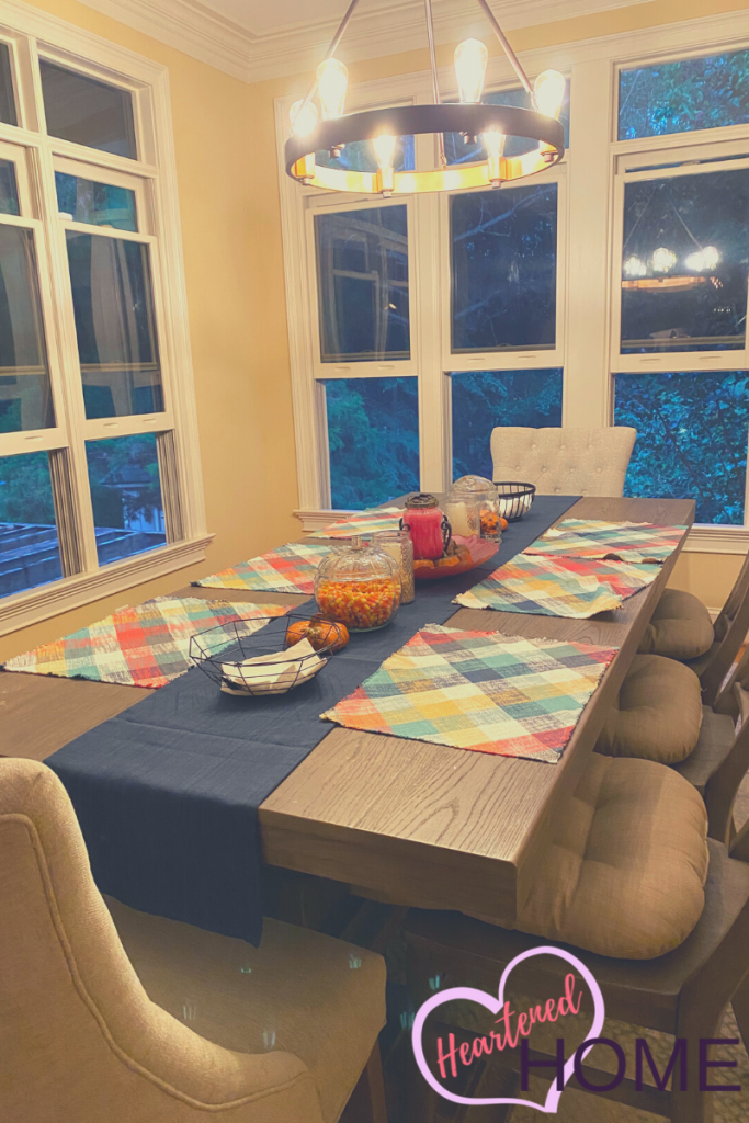 New table linens add massive impact to the finished fall look of this dining table.